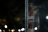 First lady Melania Trump is reflected in a glass as she attends the 97th annual National Christmas Tree Lighting ceremony at the Ellipse in President's Park near the White House in Washington, DC on December 5, 2019.<br /> Credit: Oliver Contreras / Pool via CNP