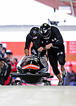 18 December 2010: Steven Holcomb starts up his 2-man bobsled for the USA, finishing in 4th place at the Viessmann FIBT World Cup Bobsled Championships on Mount Van Hoevenberg in Lake Placid, New York, USA. Mandatory Credit: Ed Wolfstein Photo