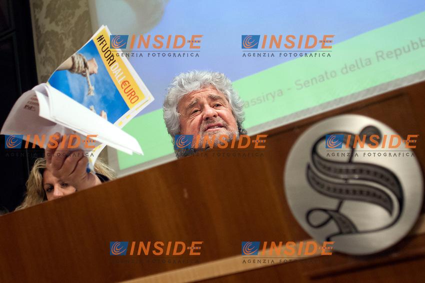 Beppe Grillo sventola dei fogli<br /> Roma 10-12-2014 Senato. Sala Nassiriya. Conferenza stampa del Movimento 5 Stelle per presentare il referendum per uscire dall'Euro dal titolo Fuori dall'Euro<br /> Press conference of the Movement 5 Stars proposing a referendum to get out of Euro<br /> Photo Samantha Zucchi Insidefoto