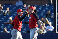 GREENSBORO, NC - FEBRUARY 25: Josh Arnold #2 and Dylan Reynolds #11 of Fairfield University react after recording the third out of the fourth inning during a game between Fairfield and UNC Greensboro at UNCG Baseball Stadium on February 25, 2020 in Greensboro, North Carolina.