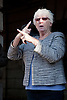Demonstration against Coalition cuts to disabled people's services and income. Sign language interpreter for deaf people.