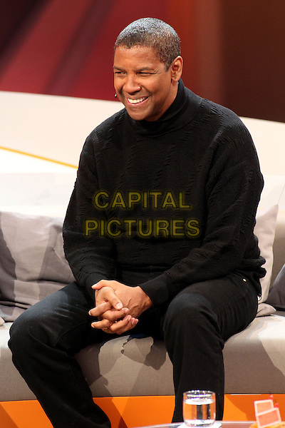 "Denzel Washington.Germany's biggest live TV-show ""Wetten Dass"", Offenburg, Germany..January 19th, 2013.half length black top jumper sweater sitting jeans denim 3/4 smiling .CAP/UNT.©Unit2/Capital Pictures"