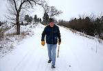"Ben Henan, 90, walks on a dirt road north of the VA Medical Center Tuesday morning in Cheyenne. Henan was raised in Fort Washakie and served in the United States Marine Corps during World War II. He watched the Battle of the Coral Sea from the deck of his transport ship and was wounded during the Battle of Guadalcanal in 1942. ""Wyoming is the greatest place on earth and I like how the wind blows away the snow here in Cheyenne."" said Henan. He also attributes his longevity to a daily walk.  To participate in WTE Photo Editor Michael Smith's 2014 Our Faces: Portraits of Laramie County project, call to make an appointment at 633-3124 or 630-8388 or email msmith@wyomingnews.com. Michael Smith/staff"
