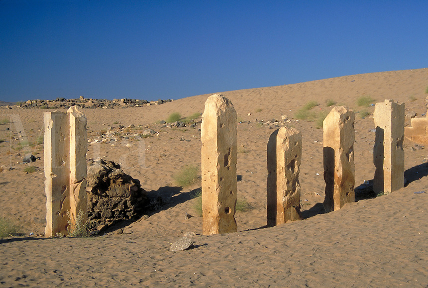 Columns of the Temple of the Sun in a sandy landscape. Archaeology, civilizations, colonnade. Ma'rib, Yemen.