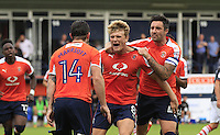Cameron McGeehan of Luton Town (centre) celebrates his second goal of the game during the Sky Bet League 2 match between Luton Town and Doncaster Rovers at Kenilworth Road, Luton, England on 24 September 2016. Photo by Liam Smith.
