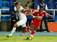 CALI -COLOMBIA-15-SEPTIEMBRE-2014. Arnold Palacio (Der)  del America de Cali disputa el balon  con Neftalí Vizcaíno (Izq) de Cortulua durante partido correspondiente a  fecha 10 del Torneo Postobon 2014 II jugado en el estadio Pascual Guerrero de la ciudad de  Cali . / Arnold Palacio (R)  of America de Cali vies for the ball with Neftali Vizcaino (L) of Cortulua during match for 10th date of Postobon Tournament 2014 II played at Pascual Guerrero stadium in Cali.  Photo: VizzorImage / Juan Carlos Quintero / Stringer