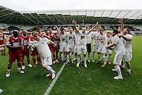 Pictured: Adam Woodyatt from Eastenders with the winning trophy flees to the left to avoid champagne sprayed by team mate Kevin Cooper (2nd R) after the end of the game. Sunday, 01 June 2014<br />