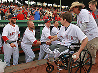 (Boston, MA  05/28/2013) RBoston Red Sox second baseman Dustin Pedroia,first baseman Mike Napoli, shortstop Stephen Drew and center fielder Jacoby Ellsbury shake hands with Boston Marathon heroes Jeff Bauman and Carlos Arredondo after the duo threw out a ceremonial first pitch at Fenway Park on Tuesday, May 28, 2013. Staff Photo by Matt West.