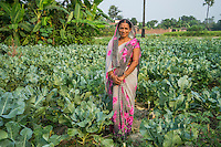 Vegetable farmer Rangila Devi, 35, a member of a Farmer's Producer Group, poses for a portrait in her cauliflower farm in Machahi village, Muzaffarpur, Bihar, India on October 26th, 2016. Non-profit organisation Technoserve works with women vegetable farmers in Muzaffarpur, providing technical support in forward linkage, streamlining their business models and linking them directly to an international market through Electronic Trading Platforms. Photograph by Suzanne Lee for Technoserve