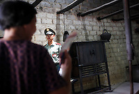 An Armed Police guard stands in the kitchen area at  Mao Zedong's former home and birthplace in Shaoshan, Hunan Province, China on 12 August 2009.