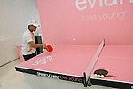 "Guest plays ping pong during the Evian ""Live Young"" photo shoot event hosted by Maria Sharapova at Openhouse Gallery on August 24, 2010."