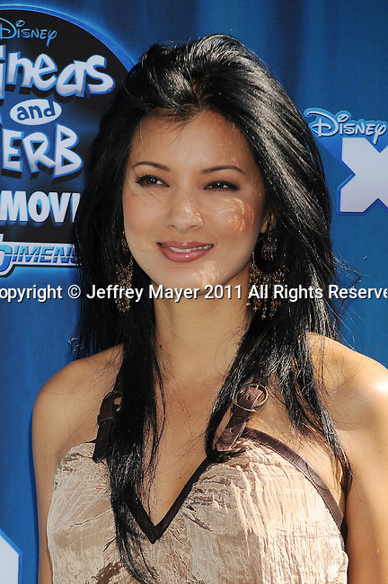 "HOLLYWOOD, CA - AUGUST 03: Kelly Hu arrives at the premiere of ""Phineas and Ferb: Across The 2nd Dimension"" at the El Capitan Theatre on August 3, 2011 in Hollywood, California."