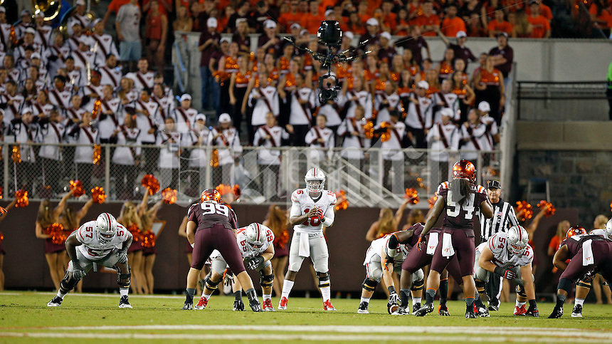Ohio State Buckeyes quarterback J.T. Barrett (16) against Virginia Tech Hokies at Lane Stadium in Blacksburg, Va on September 7, 2015.  (Dispatch photo by Kyle Robertson)