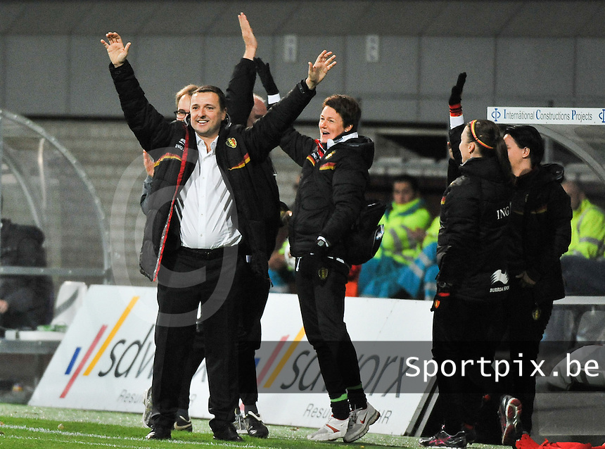 20131031 - ANTWERPEN , BELGIUM : Belgian coach Ives Serneels (left) pictured celebrating the 2-1 for Belgium with the whole bench  during the female soccer match between Belgium and Portugal , on the fourth matchday in group 5 of the UEFA qualifying round to the FIFA Women World Cup in Canada 2015 at Het Kiel stadium , Antwerp . Thursday 31st October 2013. PHOTO DAVID CATRY