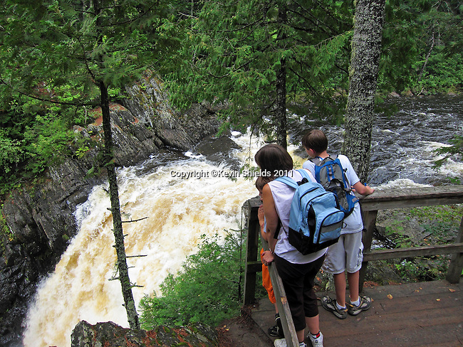Hikers at Moxie Falls, Moxie Gore, Somerset County, Maine, USA
