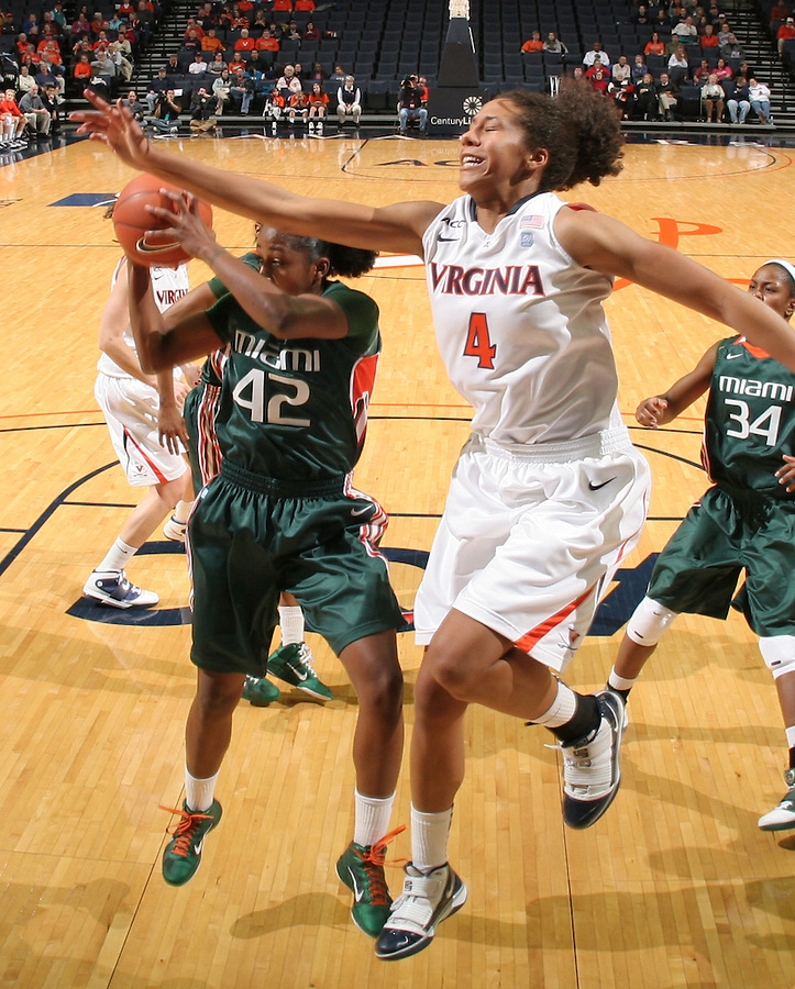 Jan. 6, 2011; Charlottesville, VA, USA; Miami Hurricanes guard Shenise Johnson (42) grabs the rebound in front of Virginia Cavaliers center Simone Egwu (4) during the game at the John Paul Jones Arena. Miami won 82-73. Mandatory Credit: Andrew Shurtleff