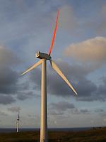 Two windmills near ocean on Oahu's north shore