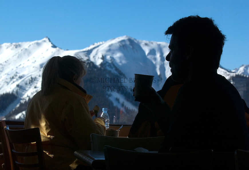 Diners at the Sundeck restaurant on the top of Aspen Mountain enjoy spectacular views of neighboring ski area Aspen Highlands. © Michael Brands.