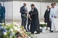 """Gedenken an die NS-Patientenmorde am Freitag den 30. August 2019 in Berlin.<br /> Mit der """"Aktion T4"""", wurden mehr als 70.000 Menschen mit koerperlichen, geistigen und seelischen Behinderungen ermordet.<br /> Im Bild: Bischof Dr. Markus Droege, Bischof der Landeskirche, legt eine weisse Rose am Mahnmal nieder.<br /> 30.8.2019, Berlin<br /> Copyright: Christian-Ditsch.de<br /> [Inhaltsveraendernde Manipulation des Fotos nur nach ausdruecklicher Genehmigung des Fotografen. Vereinbarungen ueber Abtretung von Persoenlichkeitsrechten/Model Release der abgebildeten Person/Personen liegen nicht vor. NO MODEL RELEASE! Nur fuer Redaktionelle Zwecke. Don't publish without copyright Christian-Ditsch.de, Veroeffentlichung nur mit Fotografennennung, sowie gegen Honorar, MwSt. und Beleg. Konto: I N G - D i B a, IBAN DE58500105175400192269, BIC INGDDEFFXXX, Kontakt: post@christian-ditsch.de<br /> Bei der Bearbeitung der Dateiinformationen darf die Urheberkennzeichnung in den EXIF- und  IPTC-Daten nicht entfernt werden, diese sind in digitalen Medien nach §95c UrhG rechtlich geschuetzt. Der Urhebervermerk wird gemaess §13 UrhG verlangt.]"""