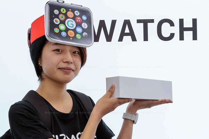 Makoto Saito wears an Apple watch hat as she poses with the newly bought product on its officail release at the Softbank Store in Omotesando, Tokyo, Japan. Friday April 24th 2015. Apple's long anticipated  smart watch was officially put on sale in stores in just nine countries. Japan and Australia which are furthest east were the first places in the world where this watch was available for purchase.