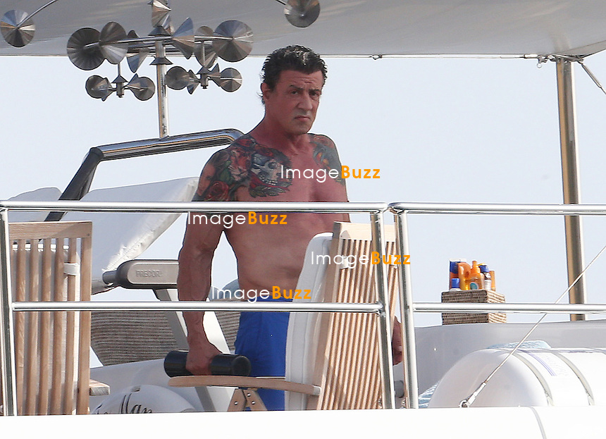"EXCLUSIVE - SYLVESTER STALLONE & FAMILY IN CORSICA - August 5th-6th, Sylvester Stallone, his three daughters Sophia, Sistine, Scarlet and wife Jennifer Flavin are still enjoying their vacation in France. After the French Riviera, Stallone & family arrived in Corsica aboard their super yacht called "" Te Manu "" , one of the most impressive charter yachts in the world with 6 staterooms beautifully decorated in soothing neutrals that can accommodate up to 12 guests. Another exceptional feature of this yacht is the elevator that connects all of her four decks. The rental price is 199.000 Euros/week."