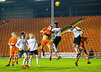 Blackpool's Owen Watkinson tries to direct a header goalward under pressure from Derby County's Archie Brown <br /> <br /> Photographer Alex Dodd/CameraSport<br /> <br /> The FA Youth Cup Third Round - Blackpool U18 v Derby County U18 - Tuesday 4th December 2018 - Bloomfield Road - Blackpool<br />  <br /> World Copyright &copy; 2018 CameraSport. All rights reserved. 43 Linden Ave. Countesthorpe. Leicester. England. LE8 5PG - Tel: +44 (0) 116 277 4147 - admin@camerasport.com - www.camerasport.com