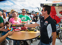 "Oct 15, 2016; Ennis, TX, USA; ""Papa John"" Schnatter, founder, chairman and CEO of Papa John's International engages with NHRA fans during qualifying for the Fall Nationals at Texas Motorplex. Mandatory Credit: Mark J. Rebilas-USA TODAY Sports"
