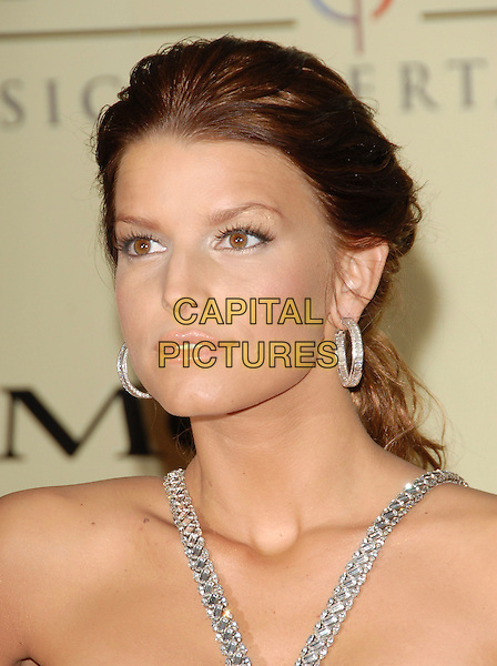 JESSICA SIMPSON.attends The Sony / BMG Post Grammy Party held at The Beverly Hills Hotel in Beverly Hills, California, USA, February 11 2007..portrait headshot hoop earrings brunette hair pouty lips.CAP/DVS.©Debbie VanStory/Capital Pictures