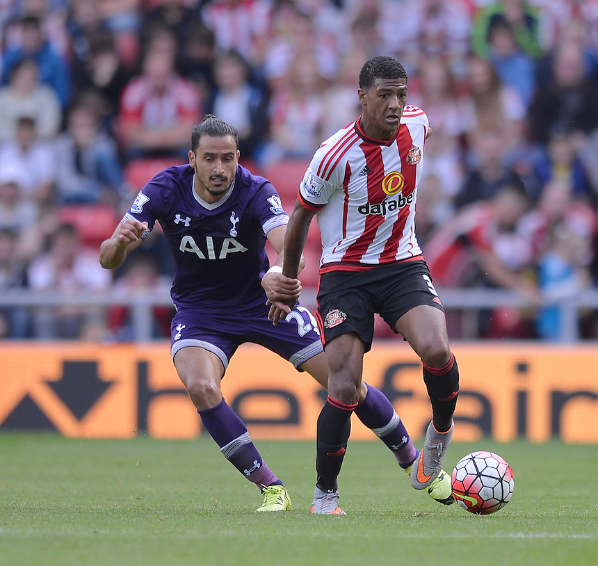 Sunderland's Patrick van Aanholt battles with Tottenham Hotspur's Nacer Chadli<br /> <br /> Photographer Dave Howarth/CameraSport<br /> <br /> Football - Barclays Premiership - Sunderland v Tottenham Hotspur - Sunday 13th September 2015 - Stadium of Light - Sunderland<br /> <br /> &copy; CameraSport - 43 Linden Ave. Countesthorpe. Leicester. England. LE8 5PG - Tel: +44 (0) 116 277 4147 - admin@camerasport.com - www.camerasport.com