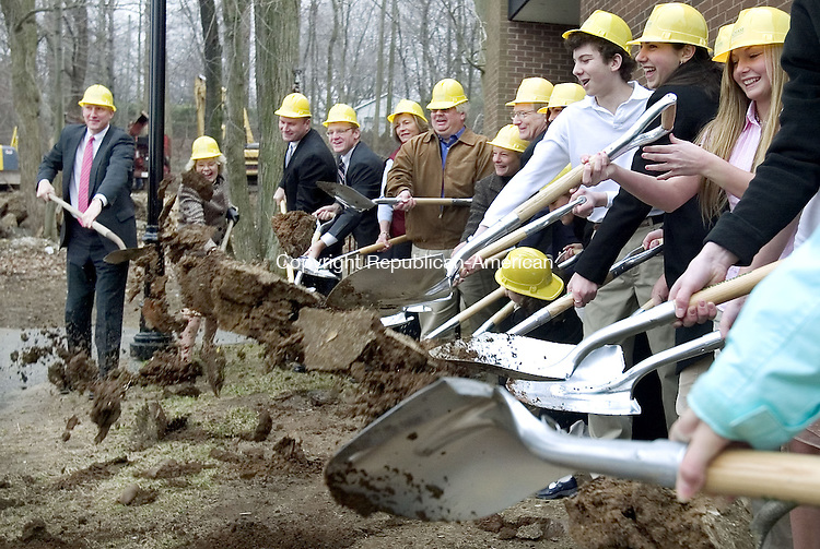 WATERBURY, CT. 03 April 2007-040307SV01--At left, Headmaster John Fixx shovels dirt with officials and students during a ceremony as Chase Collegiate School breaks ground on a new $8 million upper school building in Waterbury Tuesday<br /> Steven Valenti Republican-American