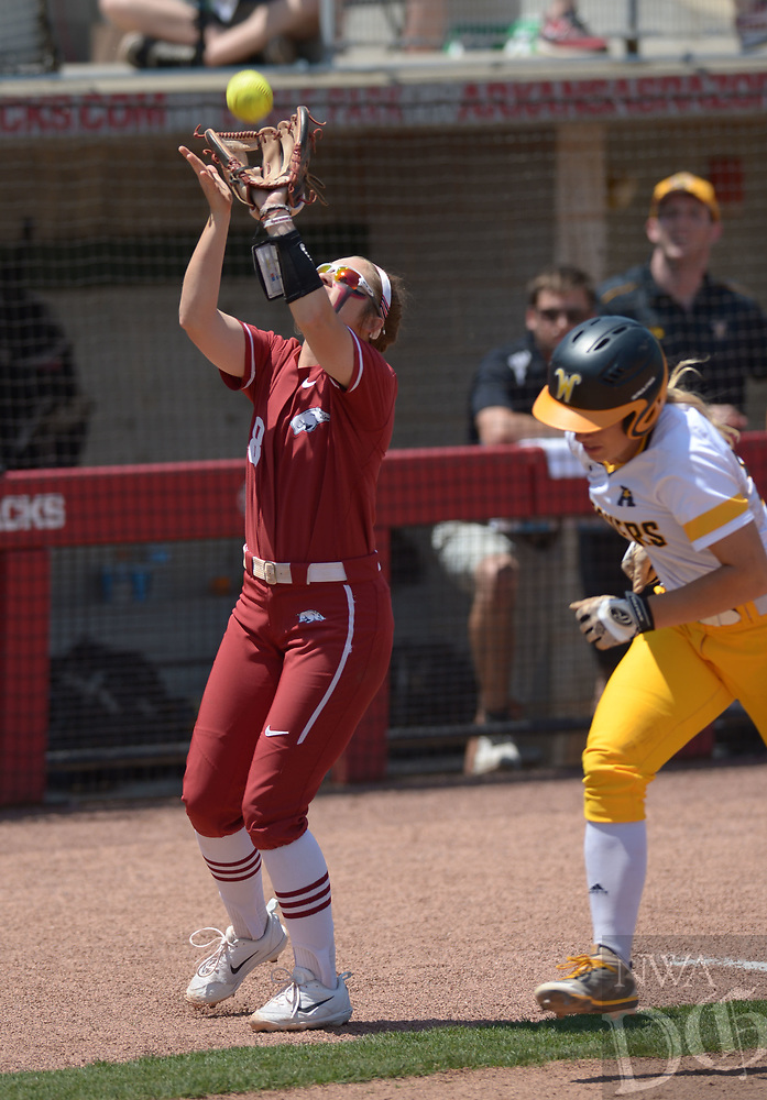 NWA Democrat-Gazette/ANDY SHUPE<br />Arkansas third baseman Autumn Buczek (left) catches a foul ball Saturday, May 19, 2018, during the third inning against Wichita State at Bogle Park during the NCAA Fayetteville Softball Regional on the university campus in Fayetteville. Visit nwadg.com/photos to see more photographs from the game.