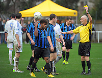 Referee Jim Murphy yellow cards Daniel Bowkett during the Central League football match between Miramar Rangers and Wellington Olympic at David Farrington Park, Wellington, New Zealand on Saturday, 17 August 2013. Photo: Dave Lintott / lintottphoto.co.nz