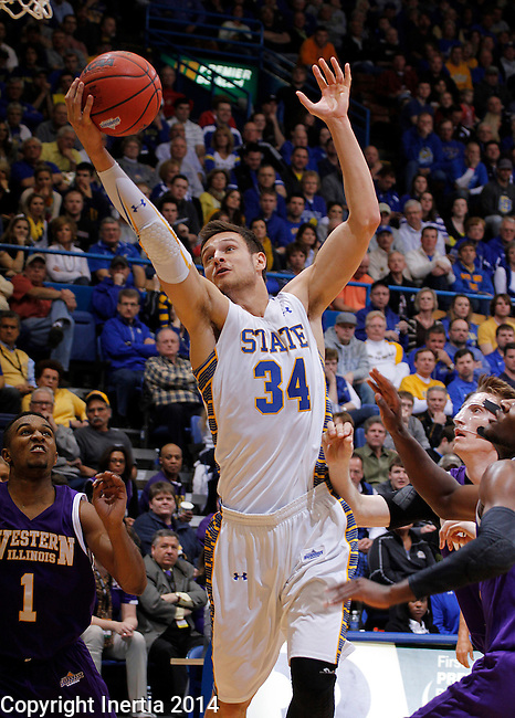 SIOUX FALLS, SD - MARCH 9:  Cody Larson #34 of South Dakota State grabs a rebound against Western Illinois during their first round game at the 2014 Summit League Basketball Championships Sunday at the Sioux Falls Arena.  (Photo by Dick Carlson/Inertia)