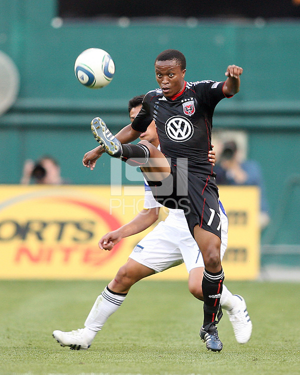 Boyzzz Khumalo #17 of D.C.United clears the ball away from Roger Espinoza #17 of the Kansas City Wizards during an MLS match at RFK Stadium on May 5 2010, in Washington DC. United won 2-1