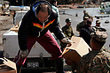 OSHIMA, Japan - A Marine with the 31st Marine Expeditionary Unit helps a local Japanese man load water onto a truck, March 27. The 31st Marine Expeditionary Unit delivered food, water, health and comfort supplies, and Japanese electrical utility vehicles to the isolated island of Oshima, in conjunction with Japanese Self-Defense Forces. The 31st involvement is part of a larger U.S. government response, after a 9.0 earthquake and subsequent tsunami struck Japan causing widespread damage. The 31st MEU is ready to support our Japanese partners and to provide assistance when called upon. (Photo by USMC/AFLO) [0006]