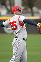 Stony Brook Seawolves infielder Kevin Courtney #25 throwing in the outfield before  a game against the  East Carolina University Pirates at Clark-LeClair Stadium  on March 4, 2012 in Greenville, NC.  East Carolina defeated Stony Brook 4-3. (Robert Gurganus/Four Seam Images)