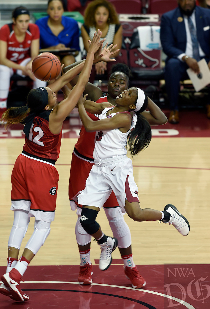 NWA Democrat-Gazette/MICHAEL WOODS @NWAMICHAELW<br /> University of Arkansas guard Malica Monk is fouled as she tries to drive past Georgia defenders Haley Clark (12) and Stephanie Paul (3) Thursday February 2, 2017 during their game at Bud Walton Arena in Fayetteville.