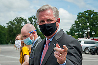 House Minority Leader Rep. Kevin McCarthy (R-Calif.) wears his face mask and fields questions from reporters following a media availability with House Minority Whip Rep. Steve Scalise (R-LA), House GOP Conference Chairwoman Liz Cheney (R-WY) and others, to announce that Republican leaders have filed a lawsuit against House Speaker Nancy Pelosi and congressional officials in an effort to block the House of Representatives from using a proxy voting system to allow for remote voting during the coronavirus pandemic, outside of the U.S. Capitol in Washington, DC., Wednesday, May 27, 2020. Credit: Rod Lamkey / CNP/AdMedia