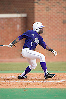 Josh Greene (1) of the High Point Panthers follows through on his swing against the UNCG Spartans at Willard Stadium on February 14, 2015 in High Point, North Carolina.  The Panthers defeated the Spartans 12-2.  (Brian Westerholt/Four Seam Images)