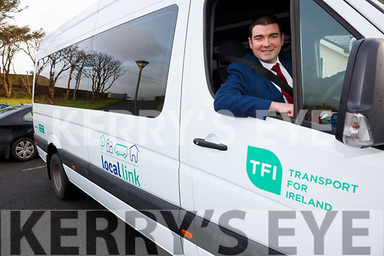 Minister of State for Tourism and Sport Brendan Griffin considers a change in career as a Kerry Local Link Bus Driver - pictured here in Tech Amergin Waterville on Monday for the official launch of the Kerry Local Link Bus Service.