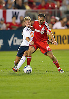 21 July 2010:   Bolton Wanderers midfielder Stuart Holden No. 25 and Toronto FC midfielder Miodrag Avdielkovic No. 36 in action during the Carlsberg Cup game between the Bolton Wanderers and Toronto FC at BMO Field in Toronto..Bolton Wanderers FC  won on penalties.