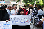 Palestinian families of martyrs and woundeds take part a protest to demand their rights and salaries, in Gaza city, on August 4, 2020. Photo by Mahmoud Ajjour