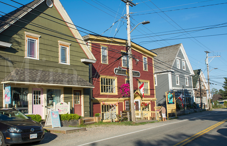 Canada Mahone Bay Nova Scotia small village with shops and traffic on Main Street in relaxing tourist town