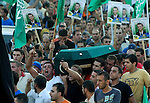 Israeli-Arab mourners carry the coffin of Ahmed Mahmoud Khatib, 29, during his funeral in the village of Manda, northern Israel, Sunday,Aug 12,2007. Khatib was shot and killed after he stole the gun of an Israeli security guard in Jerusalem's Old City Friday. Ten people were wounded in the exchange of fire and Khatib was killed. Photo By: JINIPIX / Dror Artzi