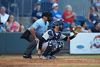Scranton/Wilkes-Barre RailRiders catcher Kyle Higashioka (66) sets a target as home plate umpire Charlie Ramos looks on during the game against the Gwinnett Stripers at Coolray Field on August 16, 2019 in Lawrenceville, Georgia. The Stripers defeated the RailRiders 5-2. (Brian Westerholt/Four Seam Images)