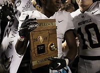 NWA Democrat-Gazette/CHARLIE KAIJO Bentonville Preston Crawford (1) holds the 7A Conference Championship plaque, Friday, November 8, 2019 following a football game at Bentonville West High School in Centerton.