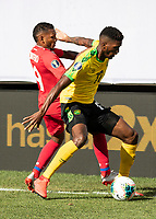PHILADELPHIA, PA - JUNE 30: Damion Lowe #17 and Alberto Quintero #19 contest the ball during a game between Panama and Jamaica at Lincoln Financial Field on June 30, 2019 in Philadelphia, Pennsylvania.