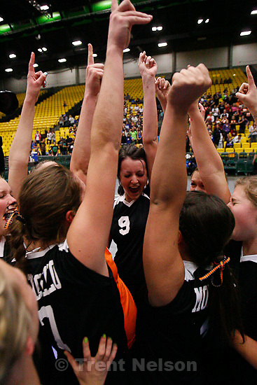 Trent Nelson  |  The Salt Lake Tribune.Monticello's Swayzi Slade (9) and her teammates celebrate their win over Rich for the 1A high school volleyball State Championship at Utah Valley University in Orem, UT on Saturday, October 29, 2011.
