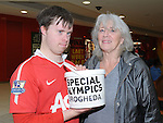 Brendan O'Shea and his mother Kay collecting funds for the Special Olympics at the Laurence Centre. Photo: Colin Bell/pressphotos.ie
