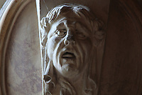 Head of a satyr with open mouth in carved stucco from a frame of a fresco by Rosso Fiorentino, 1535-37, in the Galerie Francois I, begun 1528, the first great gallery in France and the origination of the Renaissance style in France, Chateau de Fontainebleau, France. The Palace of Fontainebleau is one of the largest French royal palaces and was begun in the early 16th century for Francois I. It was listed as a UNESCO World Heritage Site in 1981. Picture by Manuel Cohen